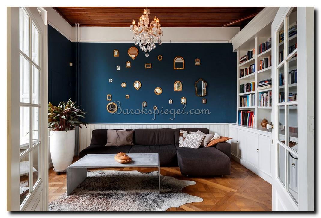 http://foto.barokspiegel.nl/blog/Grote-blauwe-muur-met-heel-veel-kleine-spiegeltjes-in-alle-vormen-en-maten.jpg