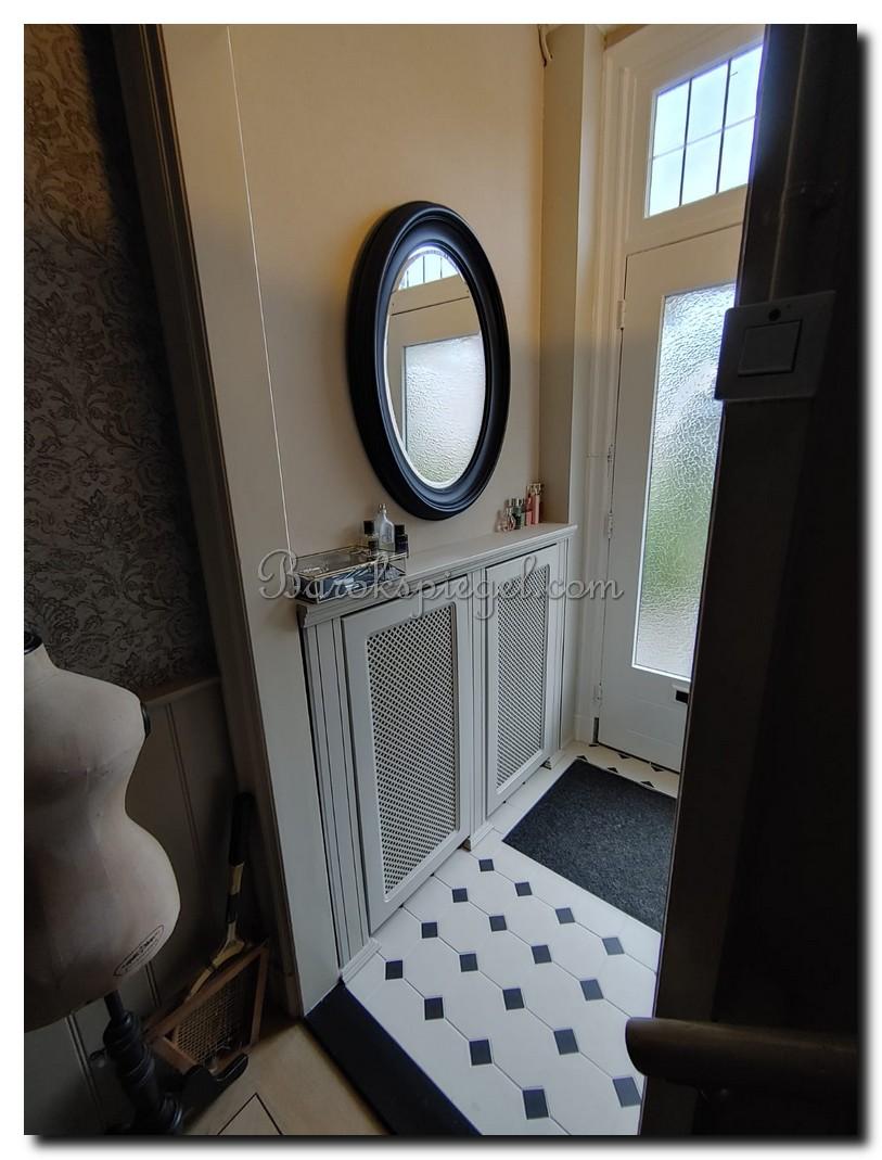 http://foto.barokspiegel.nl/brigida/Zwarte-ovale-spiegel-ovaal-zwart-in-hal%20(2).jpg