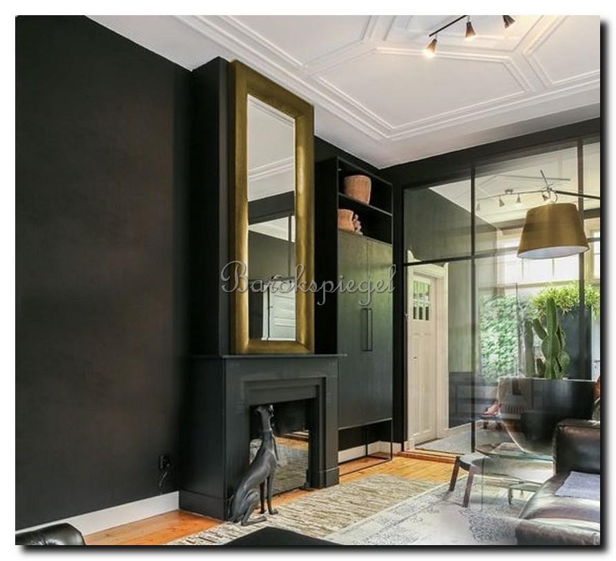 http://foto.barokspiegel.nl/enzo/Strakke-moderne-gouden-spiegel-op-zwarte-muur-boven-schouw-open-haard.jpg